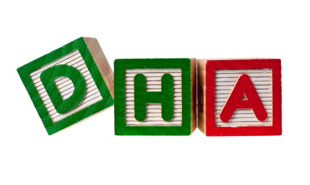 Wooden blocks forming the letters DHA isolated on white background